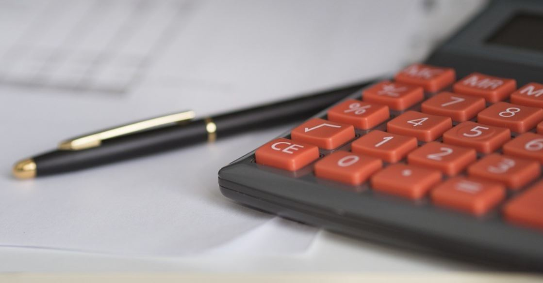 Calculator and pen on the desk