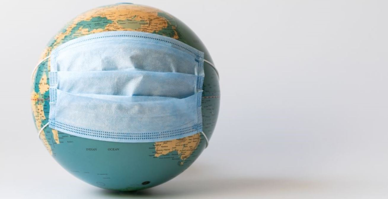 Globe wearing a facemask