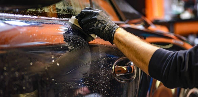 Man washing a black car