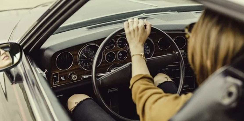 Woman drives a cool sports car