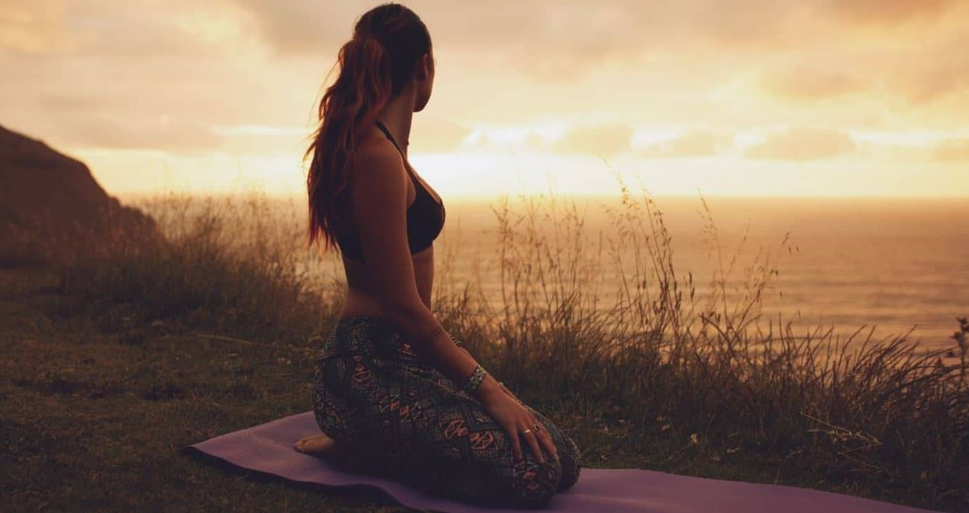 Woman exercises in dusk